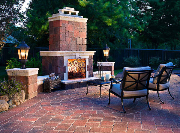 Outdoor fireplace with matching paving stones.