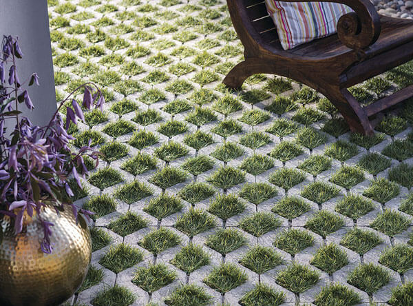 Grass pavers underneath a wooden chair.