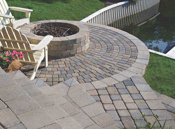 Patio fire pit with steps leading to water.