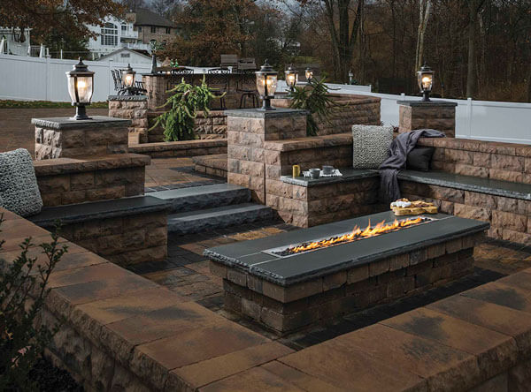 Pavers cover the entire landscape from walls to fire pit.