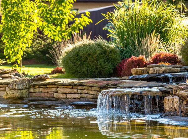 Landscape designed with waterfalls and flat stones.