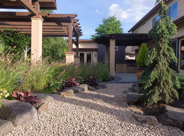 Loose pebble pathway with multiple pergolas.