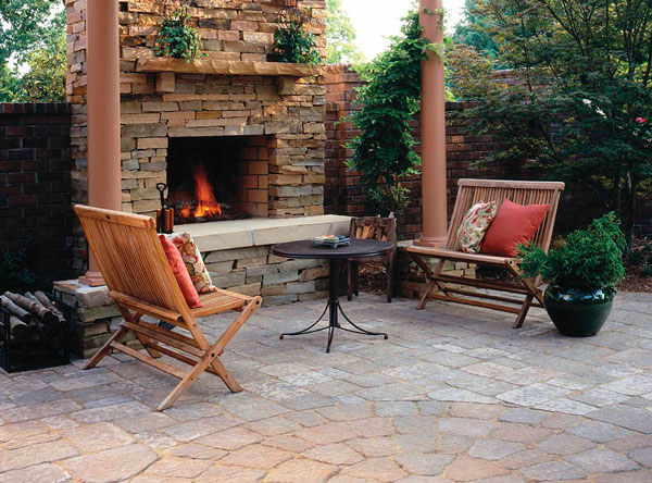 Pergola covering an outdoor fireplace area.
