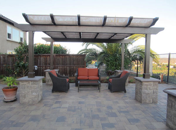 Modern pergola covering a patio seating area.