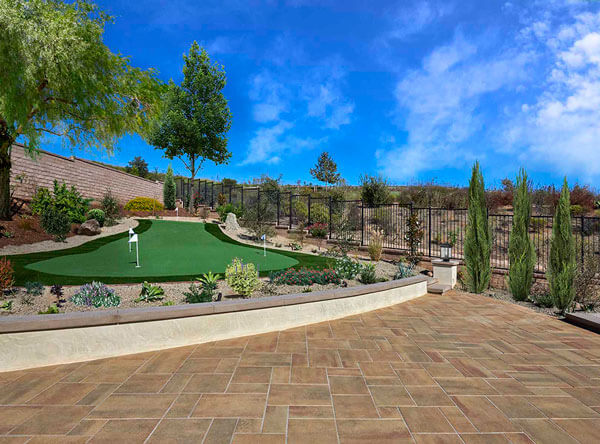 Backyard area with raised wall and putting green.
