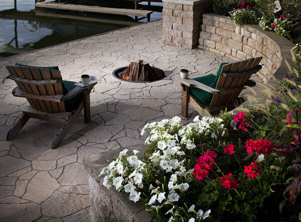 Lakeside patio area with in-ground fire pit.