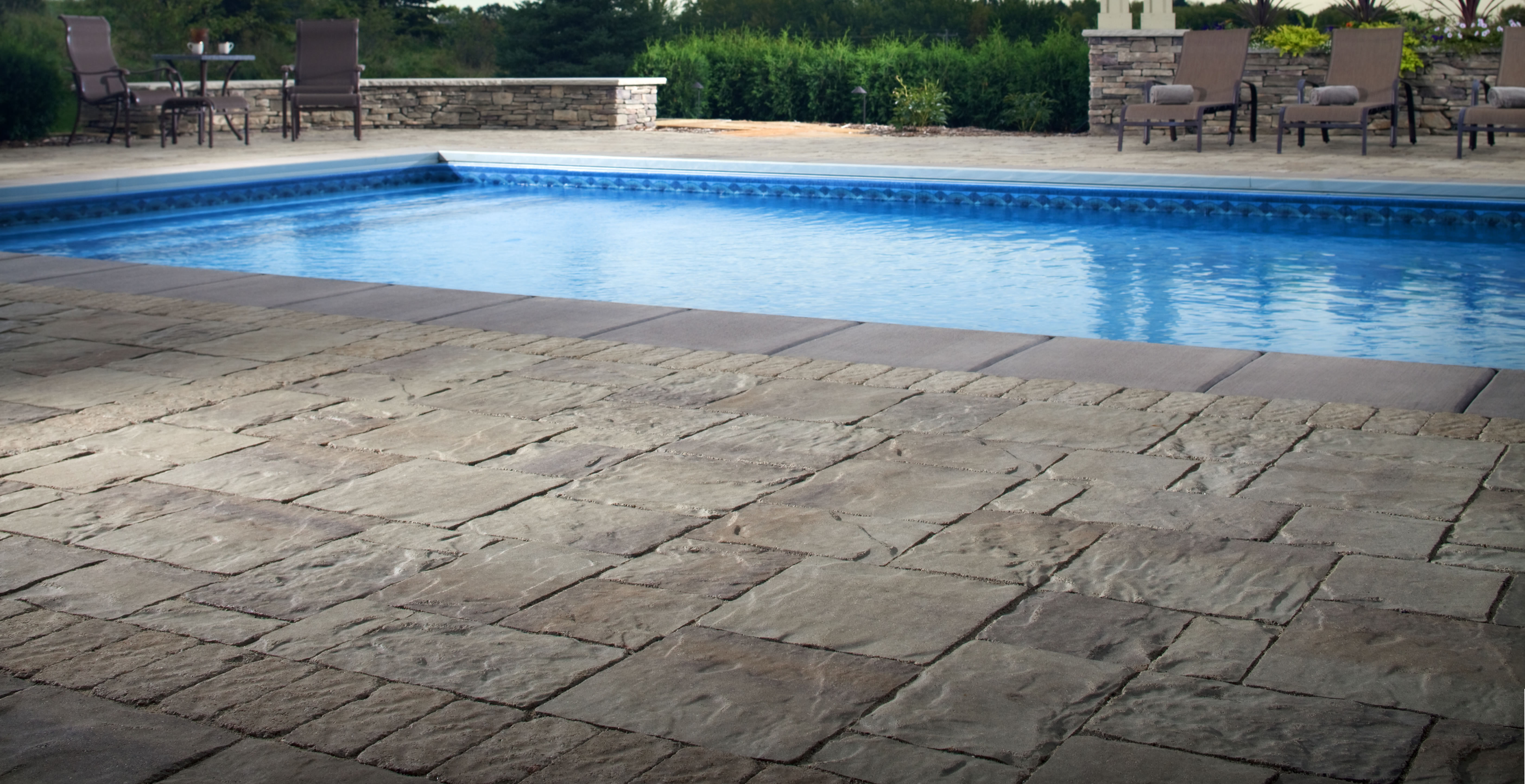 pool deck pavers turn any pool into an enticing centerpiece