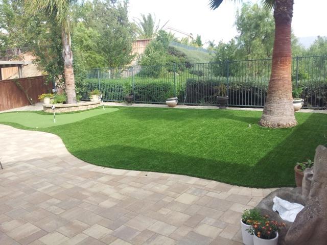 Artificial Grass vs. Real Grass Backyard Putting Green