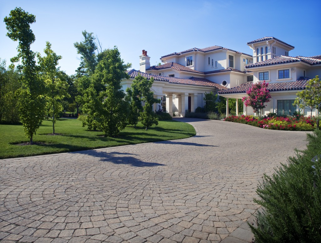 stamped concrete vs pavers cost