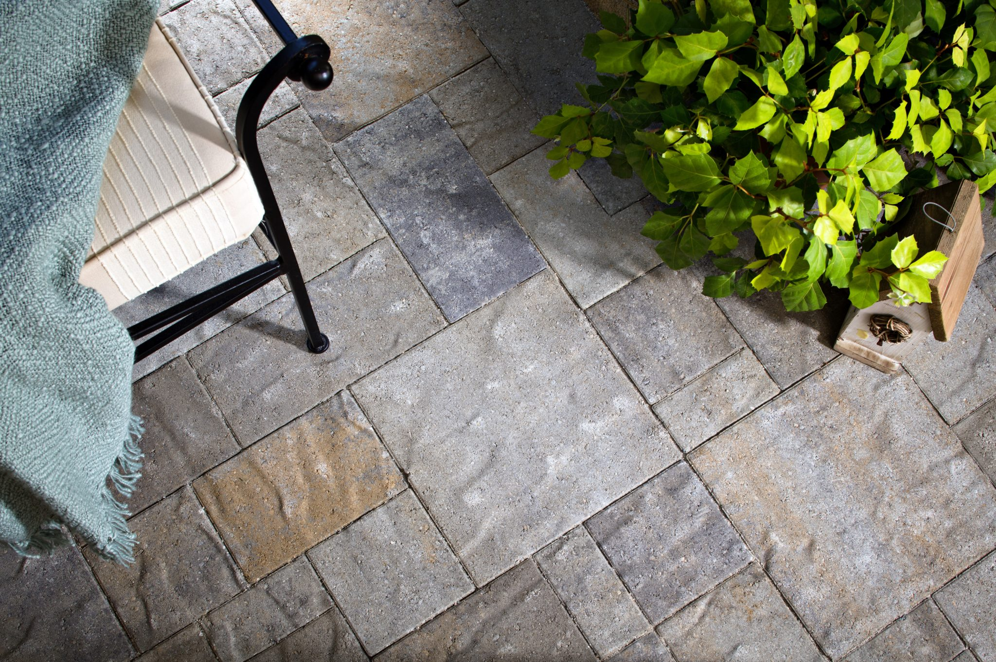 paving stones over stamped concrete