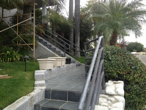 a metal railing in need of repair at a coastal San Diego home