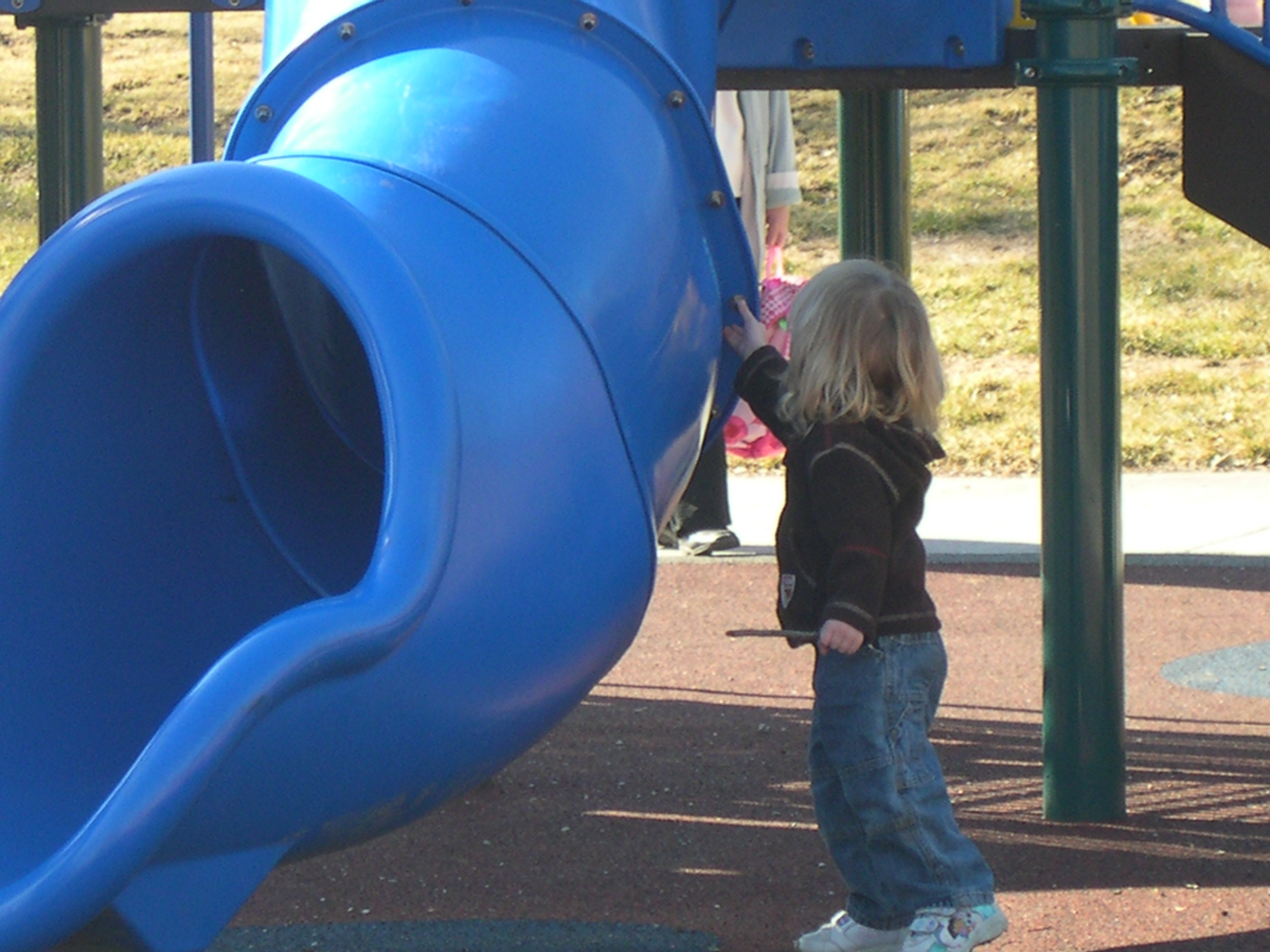 Child Playing on Rubber Playground Surface