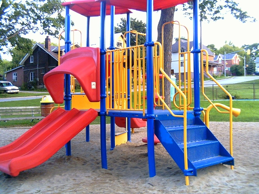 A playground with sand as the ground cover.