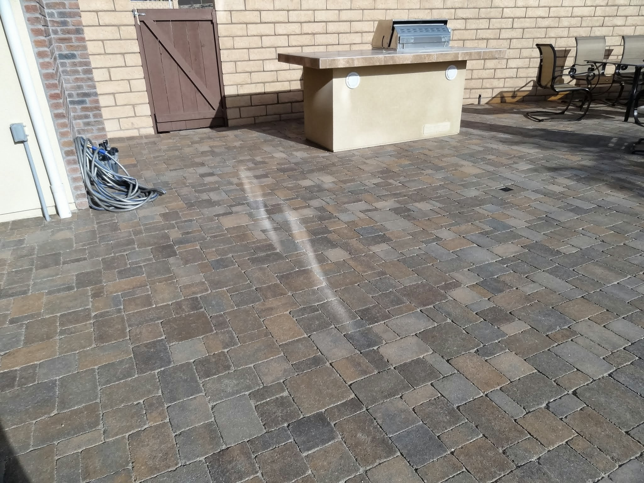 Energy Efficient Windows reflection on paving stones