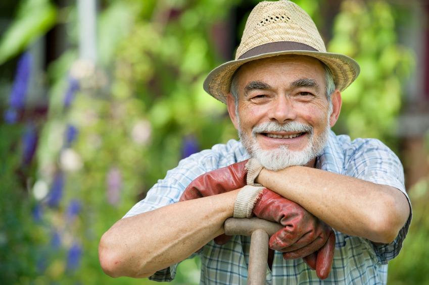 volunteer gardener with a spade