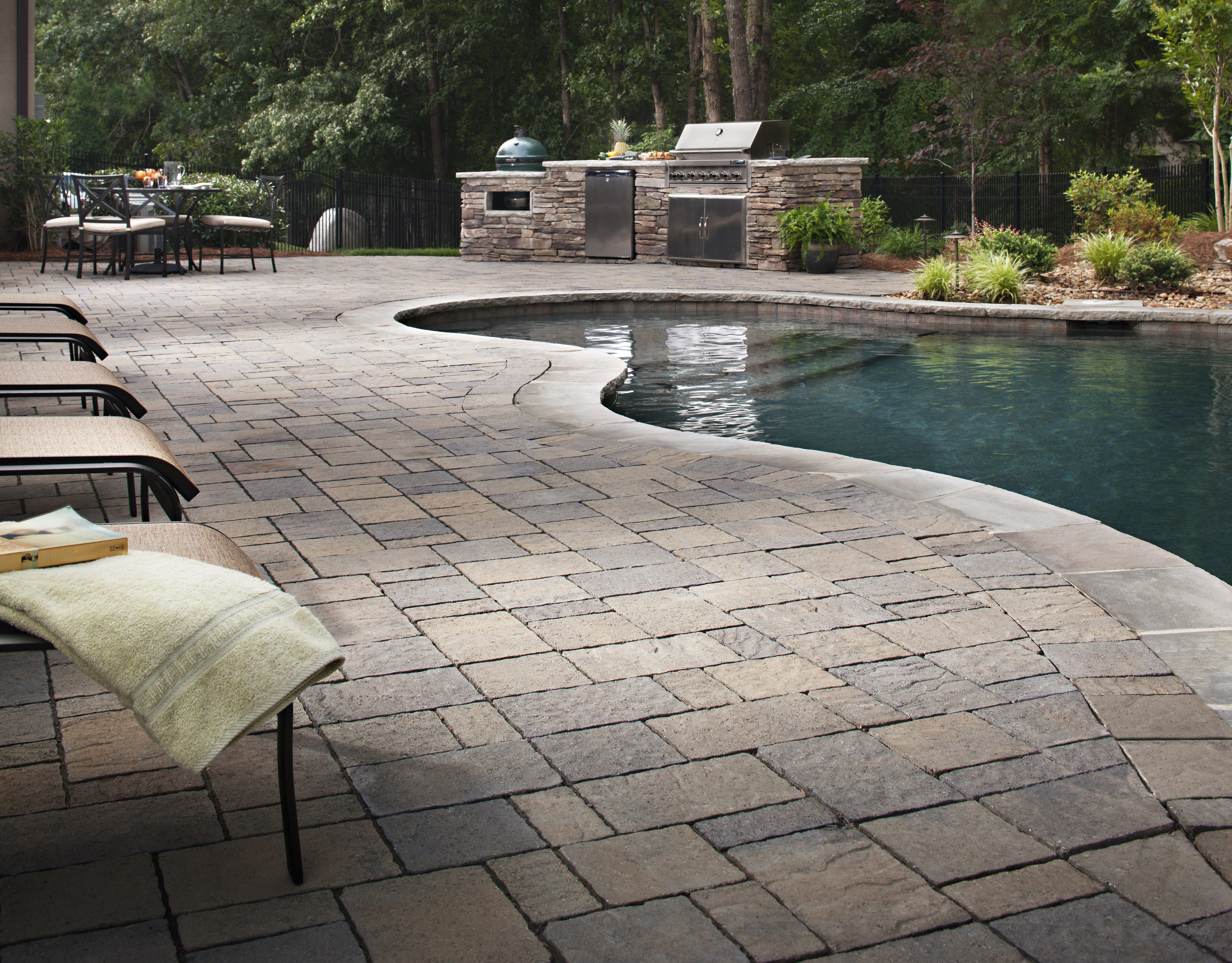 Tips for landscaping near swimming pools install it direct for Pool paving ideas