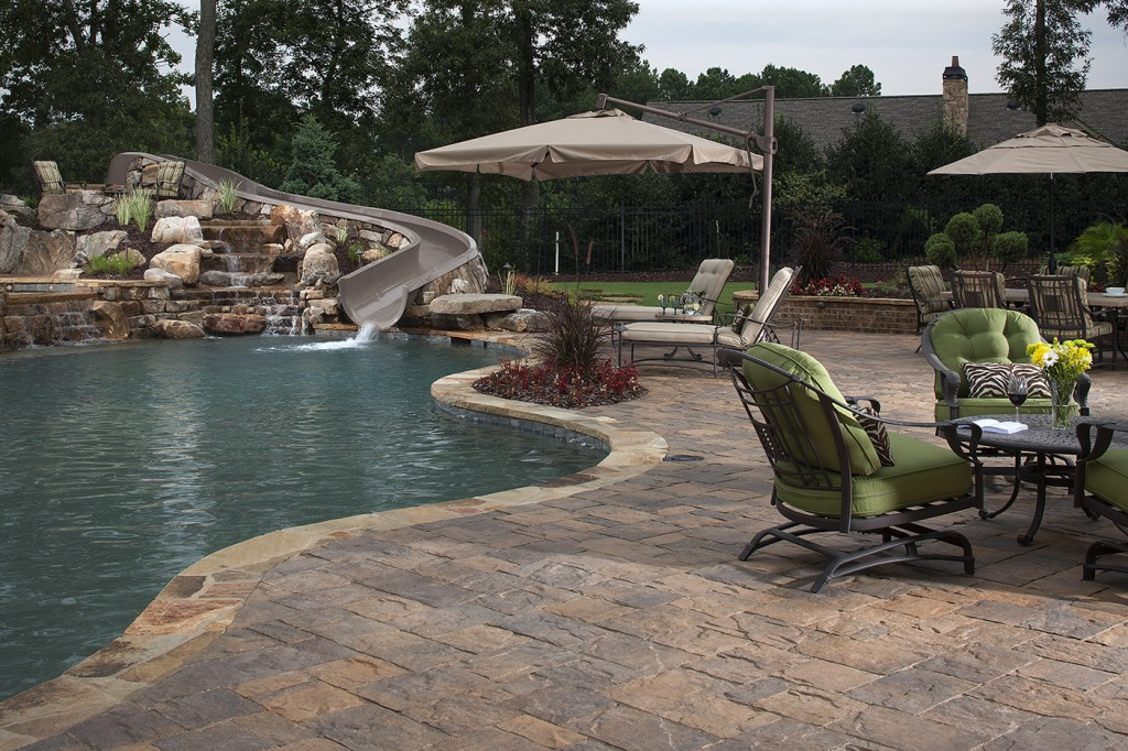 Inground Pool Landscaping Ideas infinity edge swimming pool unique waterfall Pool Decking Ideas