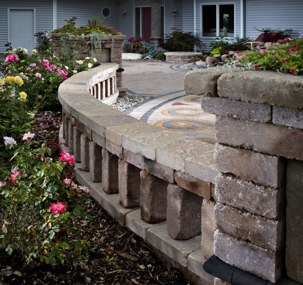 How to save water and add color with island flower beds for Flower bed wall designs