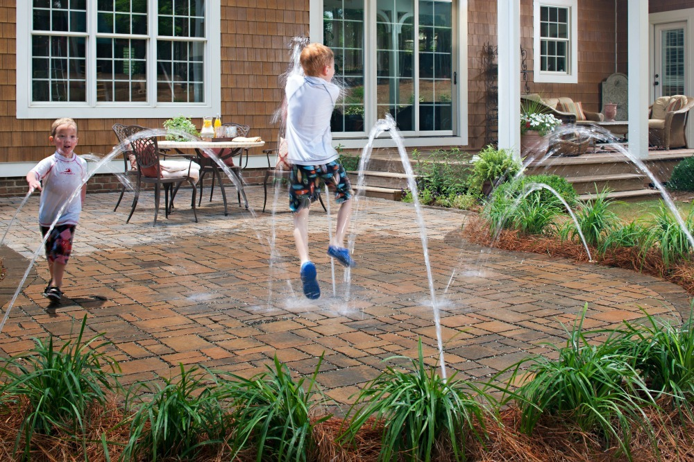 Kids' water play area with pavers