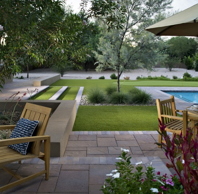A Mix of Artificial Grass and Paving Stones Adds Visual interest