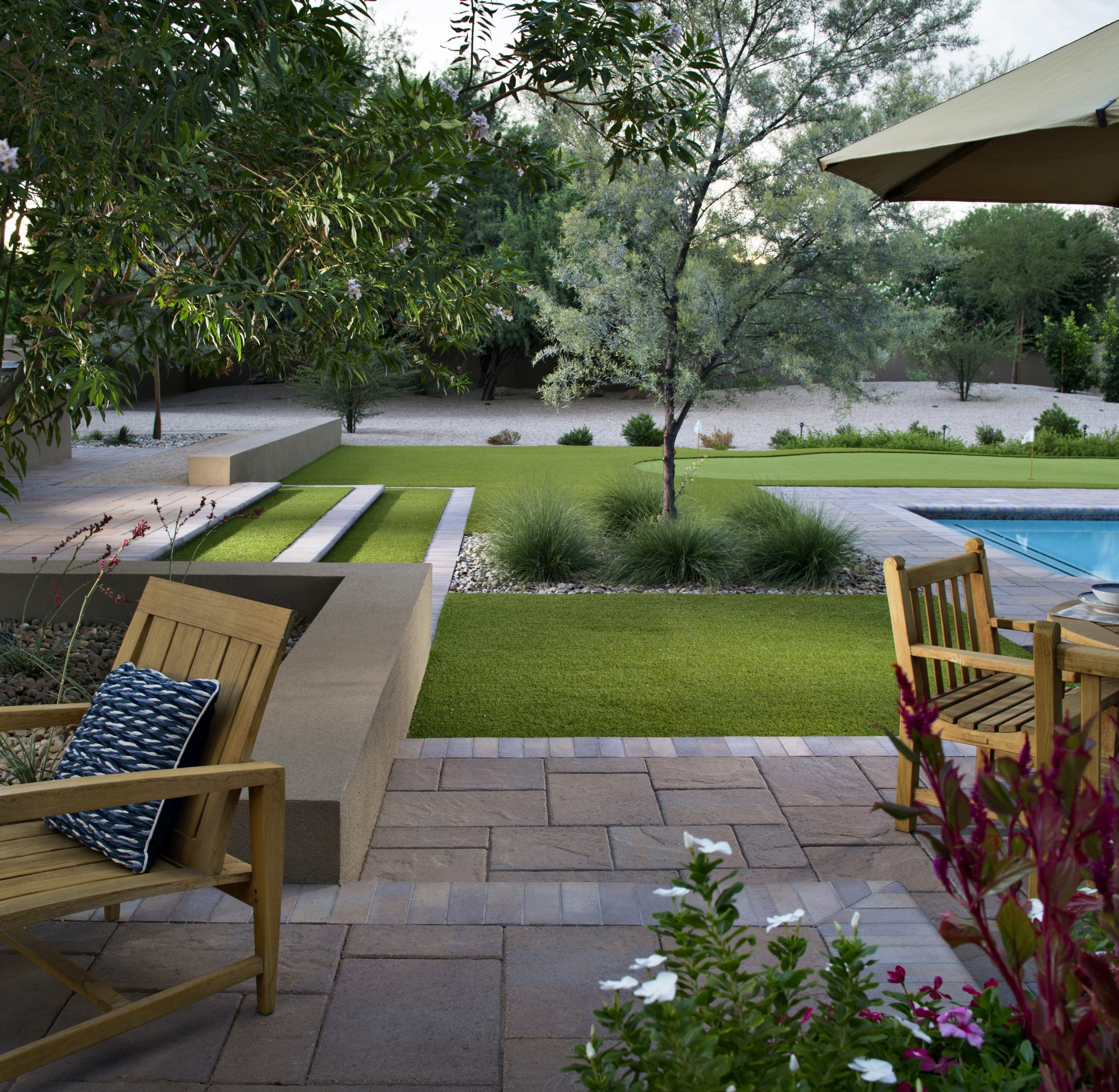 Paving Stones and Artificial Grass: Wellness retreat backyard