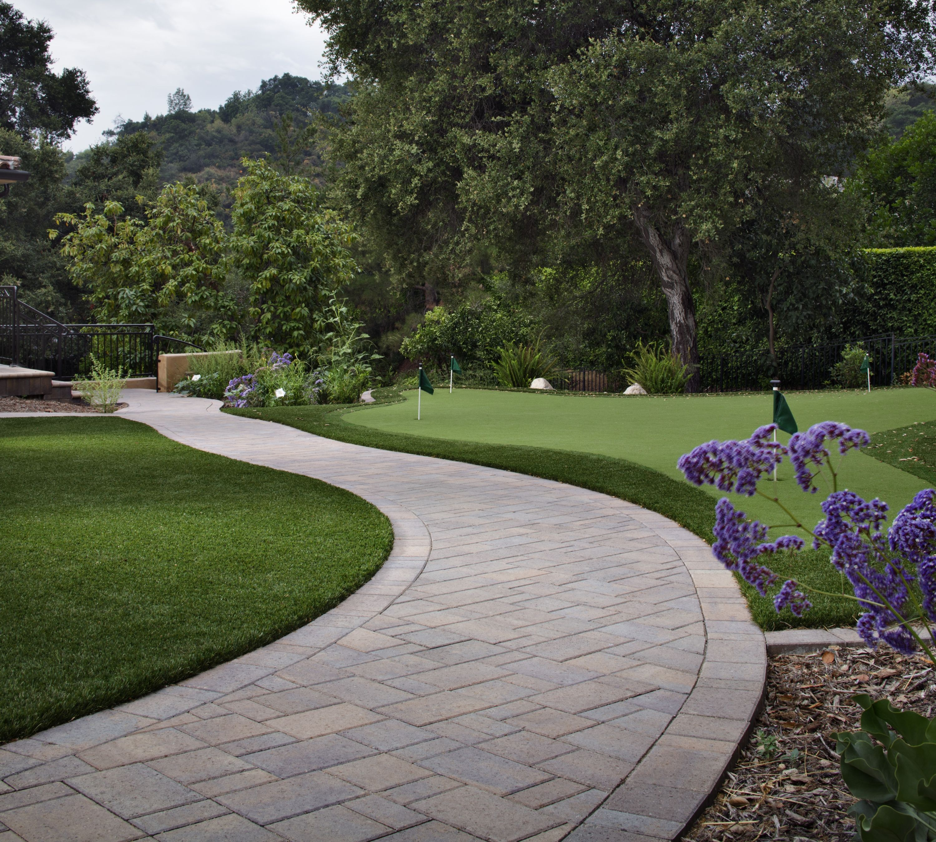 7 landscape edging ideas for artificial grass lawns install it direct - Garden pathway design ideas with some natural stones trails ...