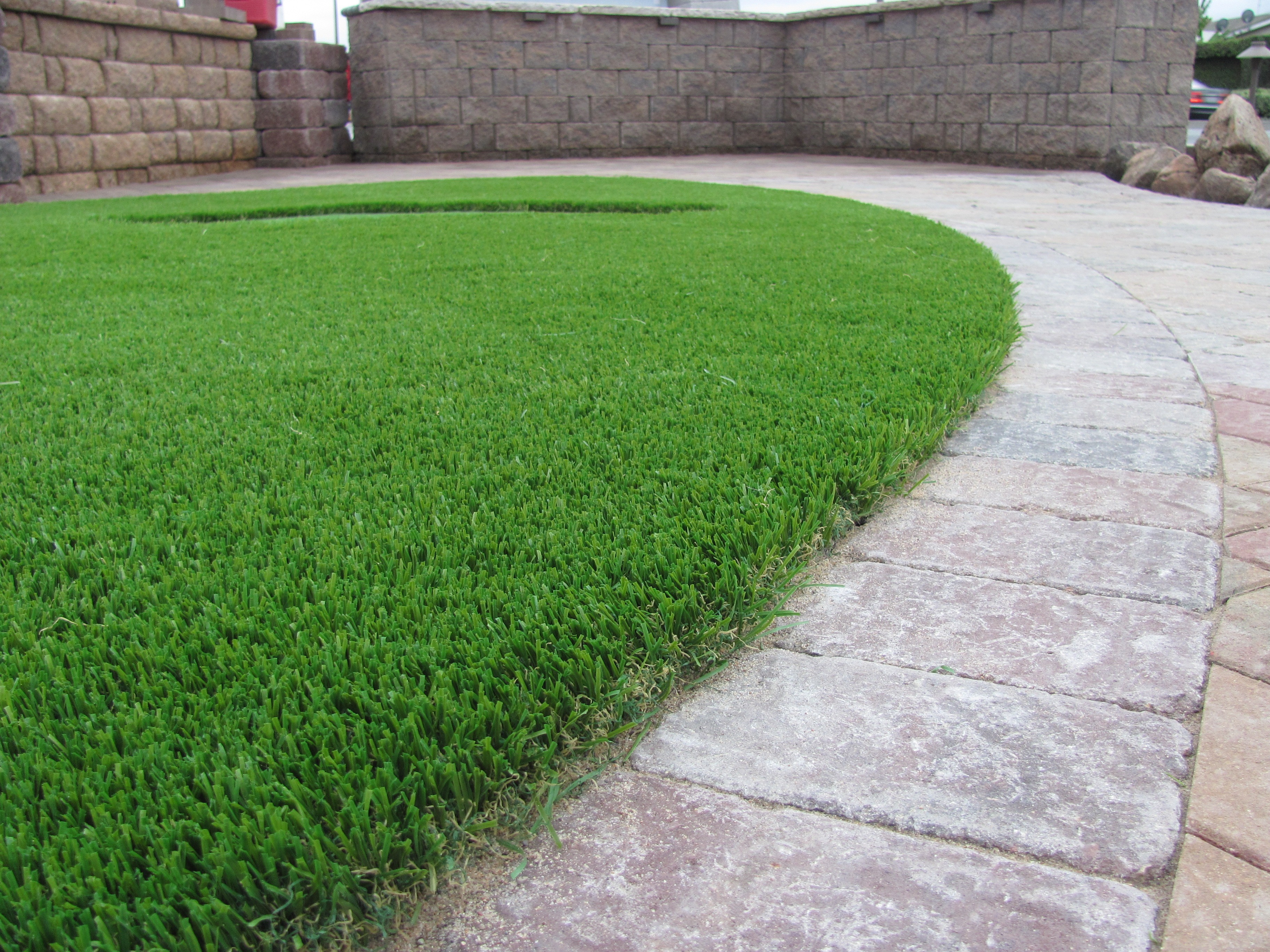 How much water can i save with artificial grass install for How much to landscape a yard