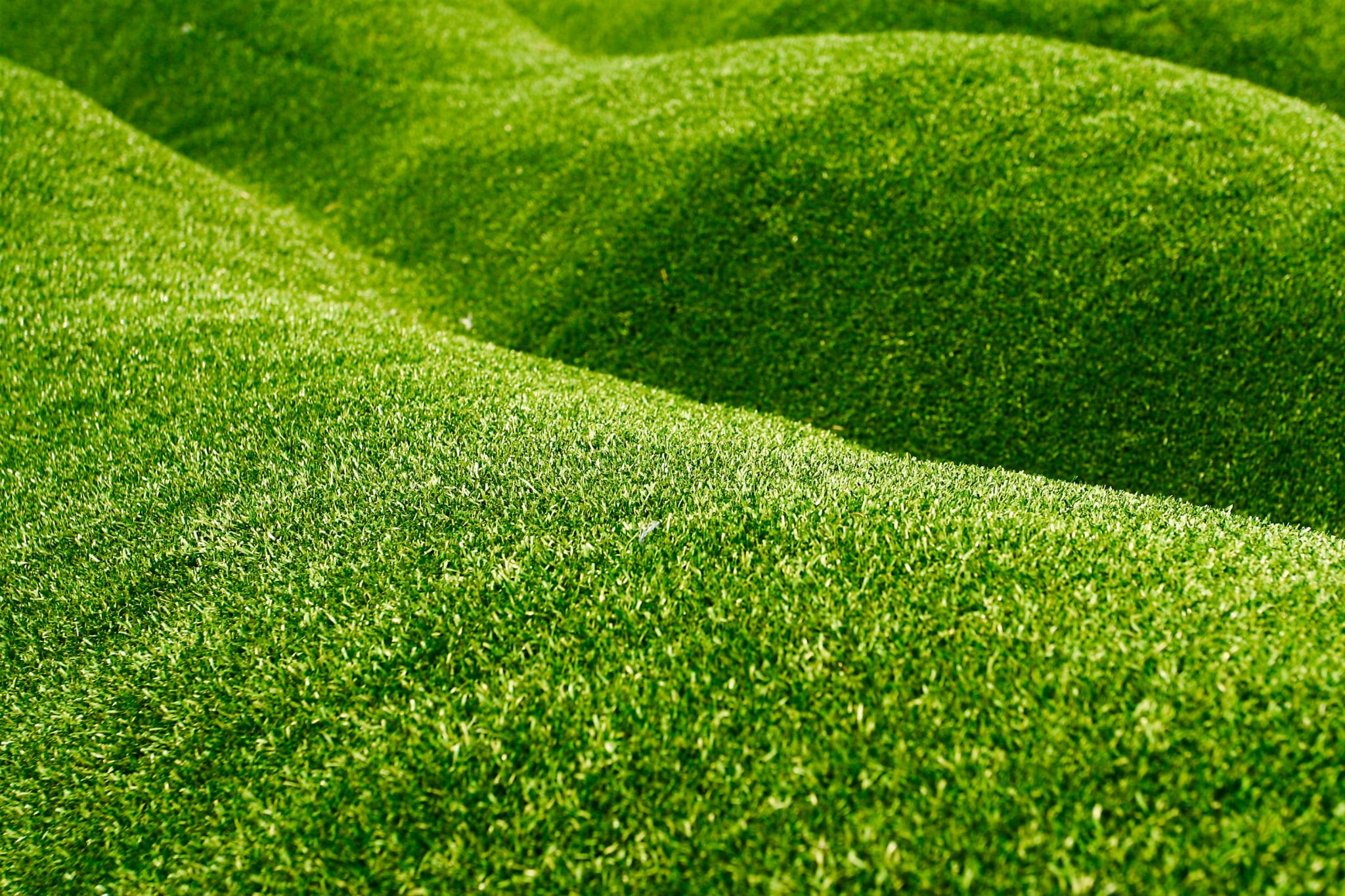 can you put artificial grass on a slope