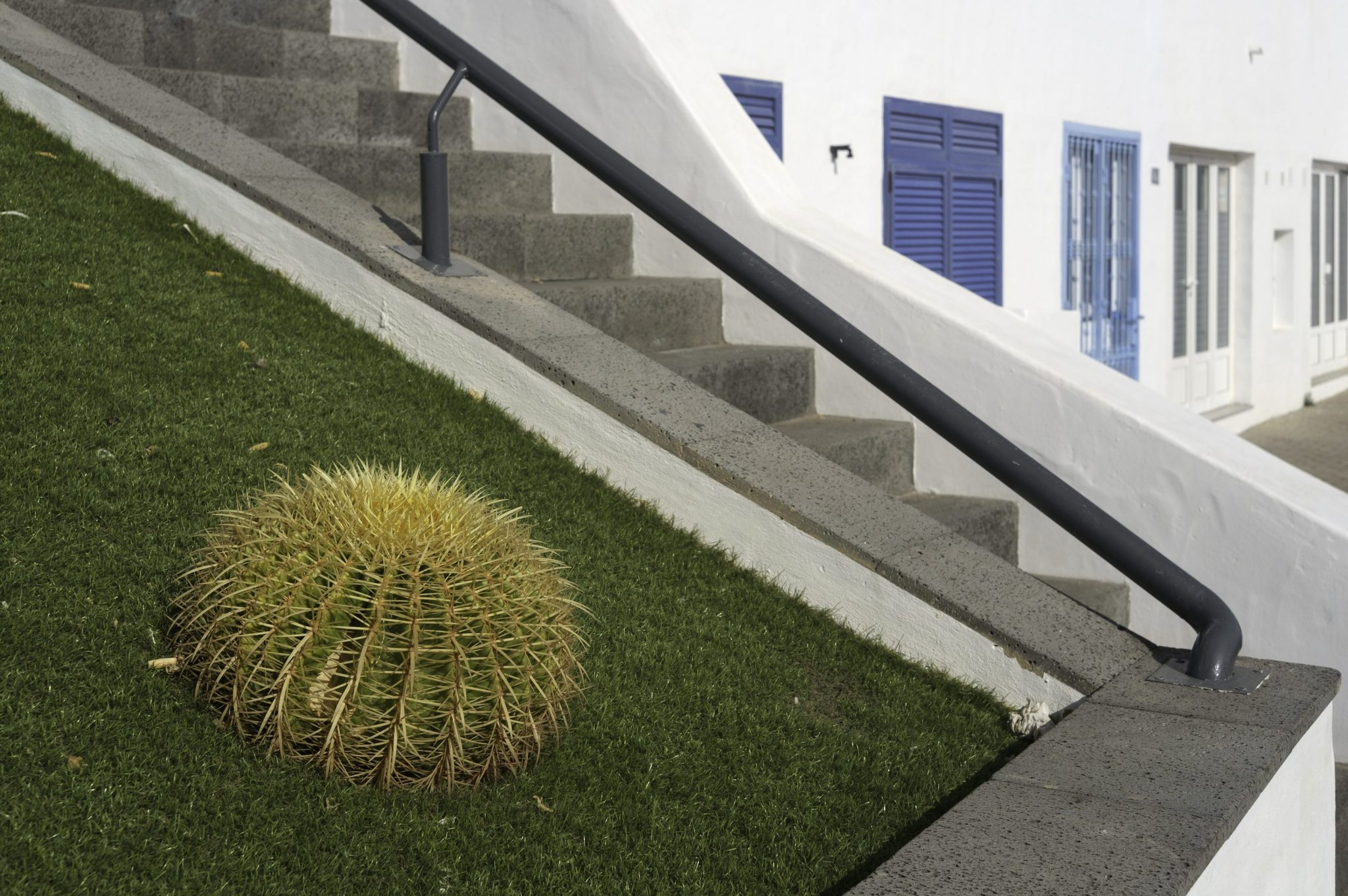 installing artificial grass on a slope