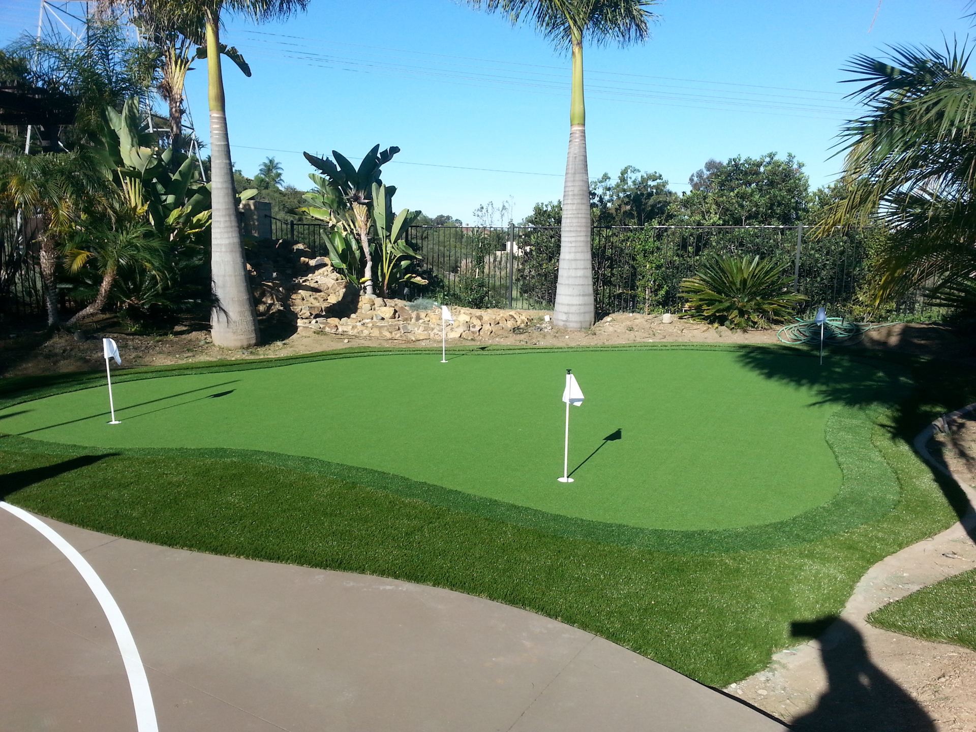 Backyard putting green installed by Install-It-Direct
