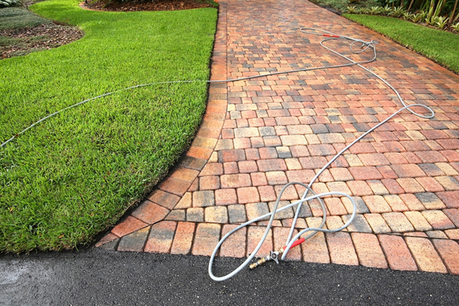 Pavers being professionally cleaned and sealed.