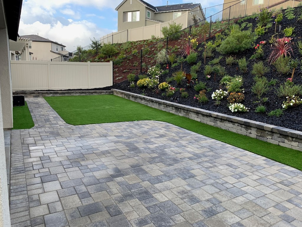 San Diego backyard with paver patio, artificial turf, retaining wall and beautiful hill landscaping