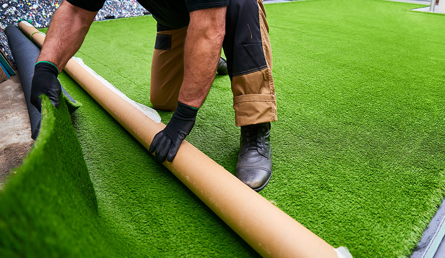 Person installing artificial grass
