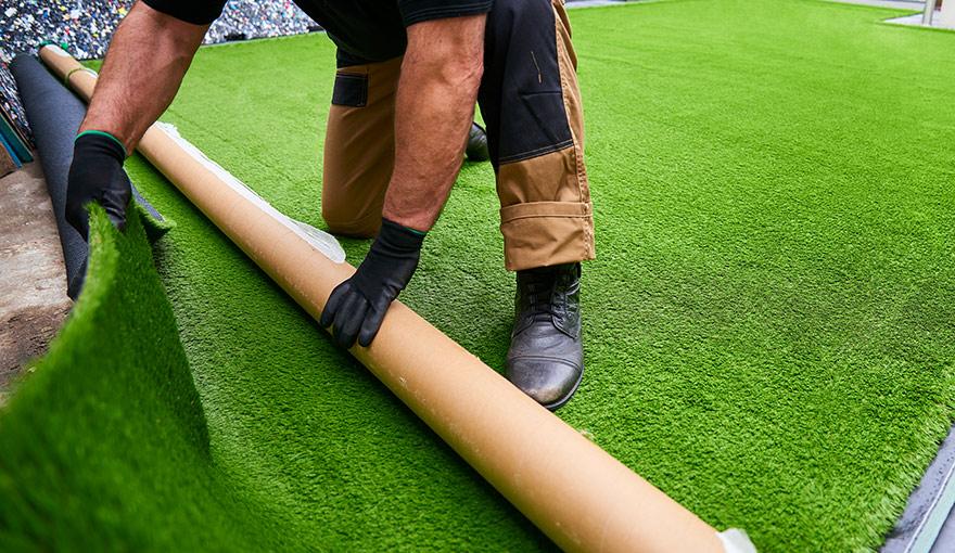 Person installing artificial grass