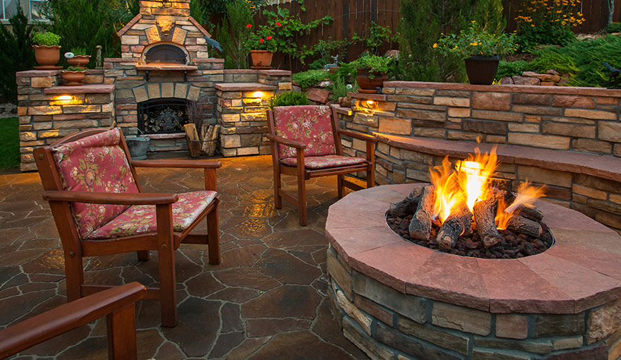 Outdoor patio with fire pit and fireplace